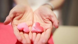 Pair of hands holding hearts